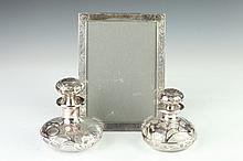 THREE STERLING SILVER DRESSING TABLE ACCESSORIES, - 8 in. x 5 1/2 in., frame inside msmts.