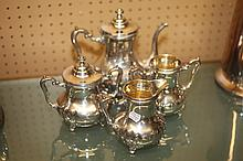 FOUR-PIECE SILVER-PLATED COFFEE SET. - 8 1/4 in. high, coffee pot.