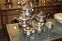 SIX-PIECE ASSEMBLED SILVER PLATED TEA AND COFFEE SERVICE. - 14 1/2 in. high.