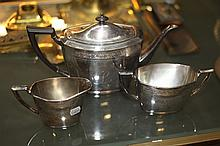 THREE-PIECE COMMUNITY SILVER PLATED TEA SET.