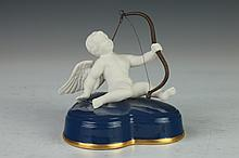 BOEHM PORCELAIN FIGURE CUPID ON HEART, Limited edition, no. 102. - 4 1/2 in. high.