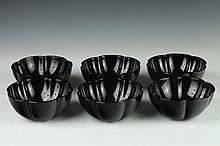 SIX BACARRAT BLACK CRYSTAL BOWLS. - 2 1/2 in. x 5 3/4 in.