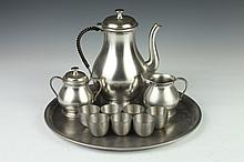 ELEVEN-PIECE ASSEMBLED PEWTER DRINKS SET, - 13 3/4 in. diam., tray.