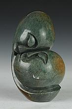 AFRICAN CARVED AND POLICHED GRREN STONE FIGURE GROUP OF EMBRACING COUPLE. - 8 1/2 in. high.