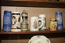 SEVEN CERAMIC STEINS. - 8 3/4 in. high, largest.