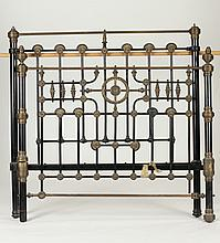 LATE VICTORIAN CAST IRON AND BRASS MOUNTED BED FRAME. Late 19th century, with ebonized metal accents. - 55 in. x 54 in.