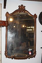GILTWOOD MIRROR, with shell-carved crest.