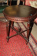 NEOCLASSICAL STYLE CARVED MAHOGANY CIRCULAR TABLE. - Height, 29 in. ; Diam., 28 in.