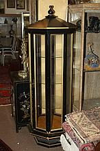 EBONIZED AND GILT OCTAGONAL DISPLAY CABINET. - 68 in x approx 25 diameter.
