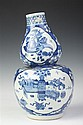 CHINESE BLUE AND WHITE DOUBLE GOURD-FORM PORCELAIN VASE. Qianlong four-character underglazed blue mark., 19th Century. - 12 in. high.
