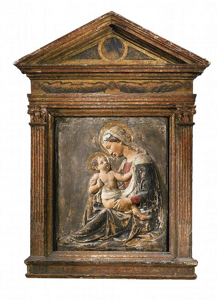 AN ITALIAN GILT AND PAINTED STUCCO RELIEF OF THE MADONNA AND CHILD, AFTER LUCA DELLA ROBBIA (1399/1400-1482), POSSIBLY LATE 15TH CENTURY