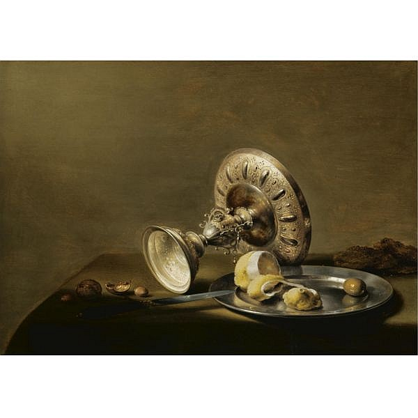 Pieter Claesz. Probably Berchem 1596/7 - 1660 Haarlem , A still life with an overturned silver tazza, a silver plate with a partly peeled lemon and an olive, with walnuts and hazelnuts on a table draped with a green cloth oil on oak panel