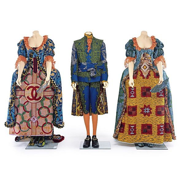Yinka Shonibare MBE three life-size mannequins, glass base, Dutch wax printed cotton textile and leather shoes