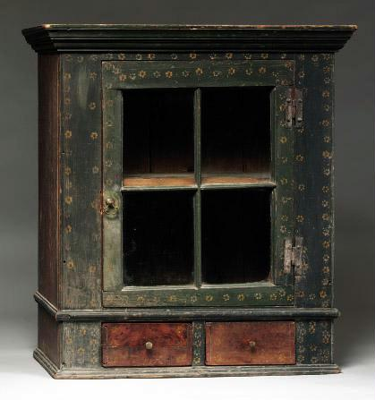 A RED-, YELLOW- AND GREEN-PAINTED PINE HANGING CUPBOARD, ATTRIBUTED TO JOHANNES BRAUN OR SAMUEL SWINEHART, MAHANTONGO VALLEY, PENNSYLVANIA CIRCA 1825