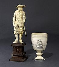 A Dieppe ivory figure together with an ivory stem cup, 19th century (2)