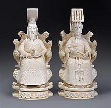 A pair of ivory carvings of an Emperor and Empresslate 19th/20th century (4)