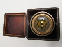 SOLID BRASS COMPASS IN WOODEN CARRYING CASE.