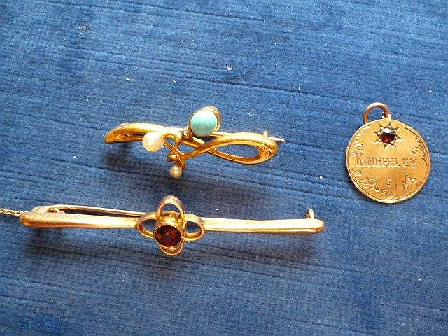 A gold and garnet bar brooch, a gold, pearl and
