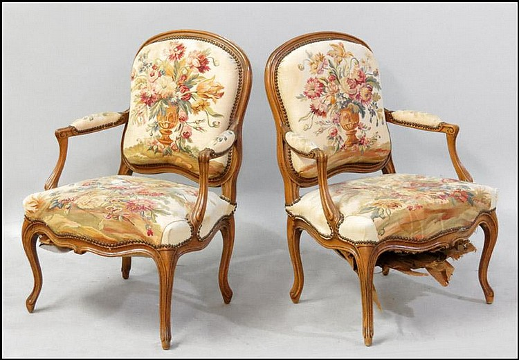 PAIR OF FRENCH CARVED WALNUT FAUTEUIL.