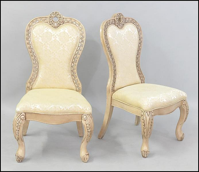 PAIR OF UPHOLSTERED HIGHBACK SIDE CHAIRS.