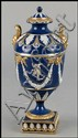 19TH CENTURY WEDGWOOD PORCELAIN COVERED URN.