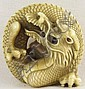 An Ivory Netsuke of a Dragon