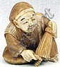 Ivory Katabori Netsuke of a man sitting with a closed parasol