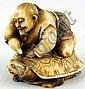 Ivory Katabori Netsuke of a Man Riding a Turtle