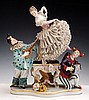 A CAPO DI MONTE PORCELAIN FIGURAL GROUP MODELED AS TWO CLOWNS WITH A WOMAN DANCING IN BETWEEN