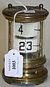 A 20th Century brass ticket clock, the glazed