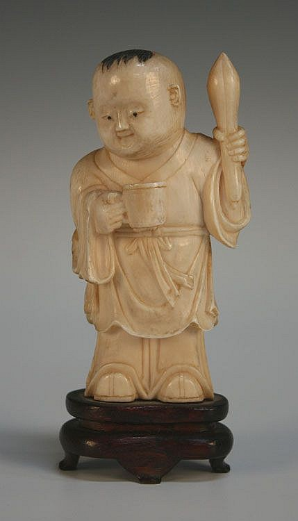 A Chinese carved ivory figure of a boy, mid-20th