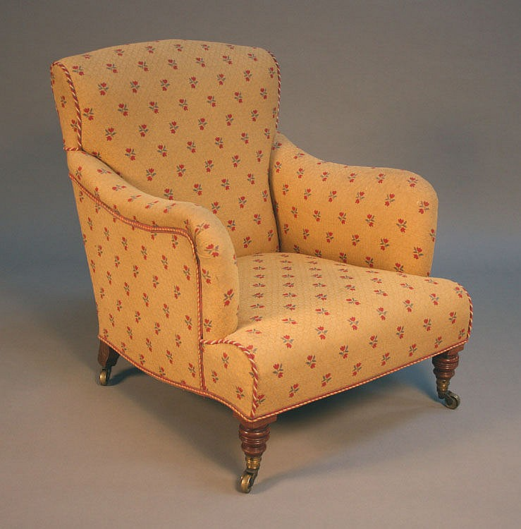 A Victorian armchair by Howard & Sons with a
