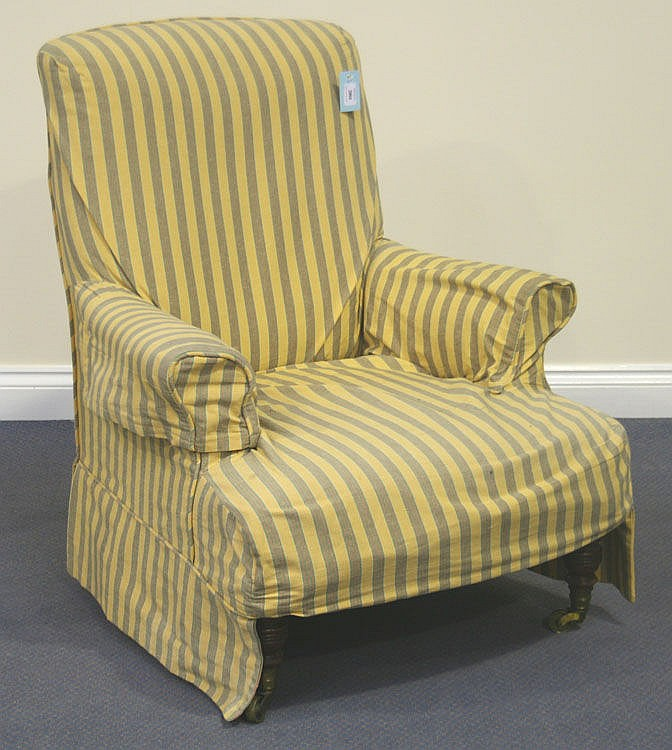 A Victorian scroll armchair by Howard & Sons,