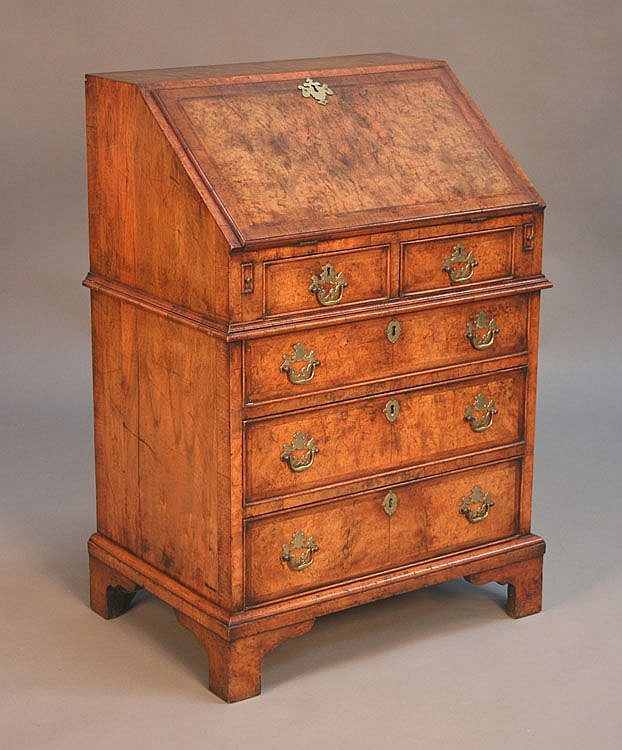 A 20th Century George I style burr walnut bureau