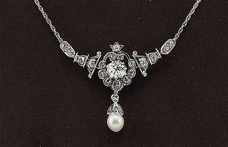 An early 20th century diamond and pearl set necklace Length from clasp to centre 22cm
