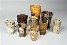 A collection of horn beakers 14cm to 6.5cm high