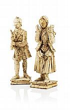 A pair of late 18th early 19th century carved and painted wooden Scottish figures 31cm and 30cm high