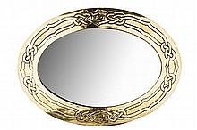 SCOTTISH SCHOOL CELTIC REVIVAL BRASS WALL MIRROR, CIRCA 1920 54cm x 63cm