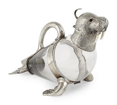 A novelty silver plated walrus decanter 35cm long