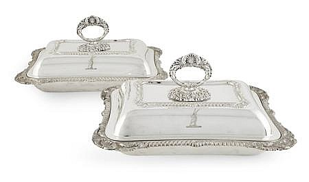 A pair of silver plated entree dishes and covers 27cm wide