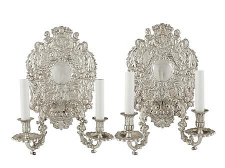 A pair of 17th century style silver plated twin light wall sconces 36cm high