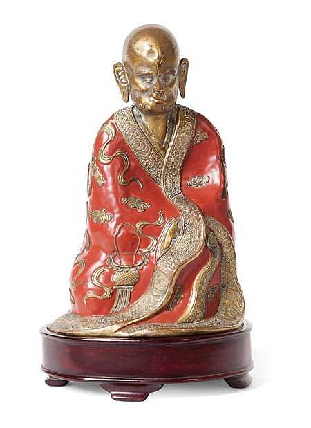 A CLOISONNE FIGURE OF A LUOHAN QING DYNASTY, 19TH CENTURY 16.5cm high (excluding stand)
