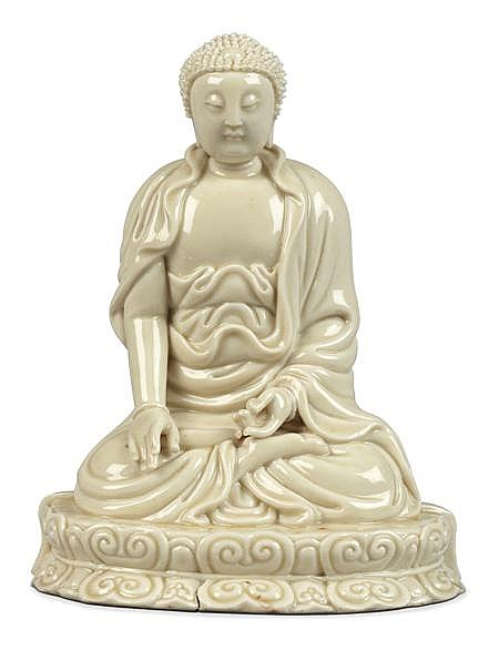 A BLANC DE CHINE SEATED FIGURE OF BUDDHA 19TH CENTURY 17cm high approx.