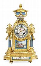 FRENCH PORCELAIN AND GILT METAL MANTEL CLOCK EARLY 20TH CENTURY 37cm high, 24cm wide