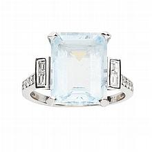 An 18ct gold mounted aquamarine and diamond set ring Ring size: M, estimated total gem weights: aquamarine 5.50cts, diamonds 0.18cts