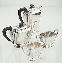 A modern four piece silver tea service Height of waterpot: 19cm, combined weight: 50oz
