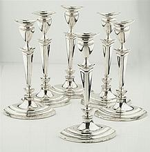 A set of six table candlesticks Height: 30cm