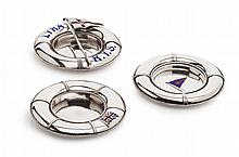 A group of three silver and enamel ashtrays Largest:115mm