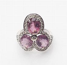 A pink tourmaline and diamond set cluster ring Ring size: P