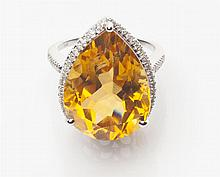 A citrine and diamond set cocktail ring Ring size: M/N